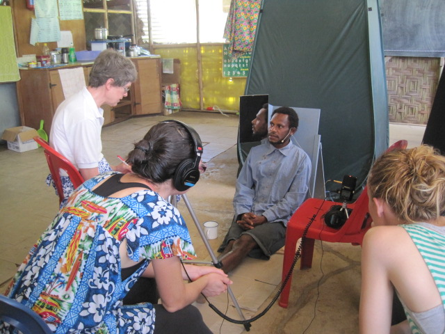 Language documentation team recording Segi word list. July 2014, Tring Village, ESP, PNG.